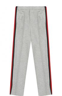 Спортивные брюки с контрастными лампасами Gucci