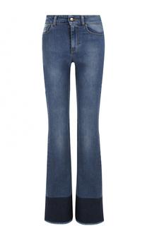 Расклешенные джинсы с потертостями и бахромой REDVALENTINO