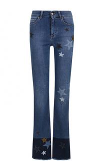 Расклешенные джинсы с декоративной отделкой в виде звезд REDVALENTINO