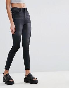 Черные выбеленные джинсы скинни с рваной отделкой ASOS RIDLEY - Черный