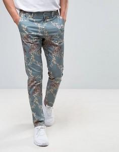 Зауженные брюки с цветочным принтом ASOS - Зеленый