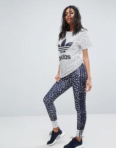 Темно-синие леггинсы с принтом и тремя полосками adidas Originals - Темно-синий