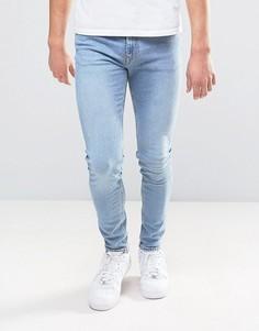 Синие супероблегающие джинсы Weekday - Синий