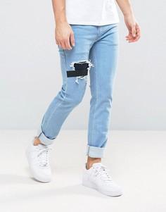Узкие эластичные джинсы с нашивками и прорехами Religion - Серый