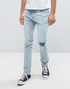 Выбеленные рваные укороченные джинсы скинни с заплатами Hollister - Синий