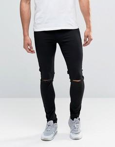 Черные джинсы с напылением и рваными коленями ASOS - Черный