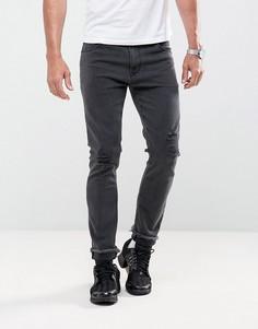 Черные выбеленные укороченные джинсы скинни с рваной отделкой ASOS - Черный