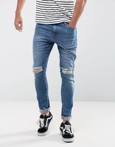 Синие выбеленные супероблегающие джинсы плотностью 12,5 унции с рваными коленями ASOS - Синий