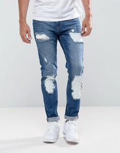 Синие джинсы скинни с рваной отделкой ASOS - Синий