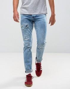 Синие джинсы слим в винтажном стиле с рваной отделкой ASOS - Синий