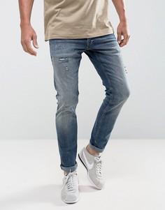 Узкие джинсы с рваной отделкой Jack & Jones Intelligence - Синий