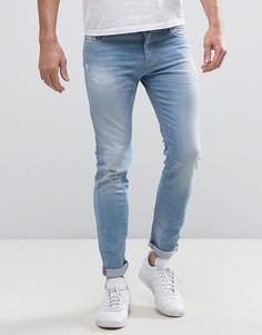 Светлые джинсы скинни с потертостями United Colors of Benetton - Синий