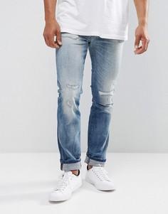 Светлые суженные книзу джинсы слим Wrangler Larston - Синий