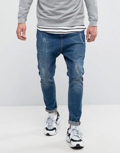 Рваные джинсы с заниженным шаговым швом ASOS - Синий