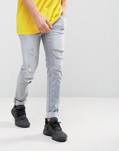 Светло-серые зауженные джинсы с рваной отделкой ASOS - Серый
