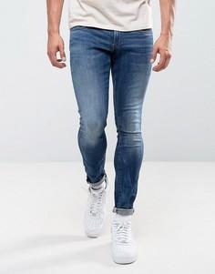 Выбеленные суперузкие джинсы цвета индиго с потертостями G-Star 3301 - Темно-синий