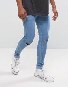 Супероблегающие джинсы с рваными коленями и необработанным краем Criminal Damage - Синий