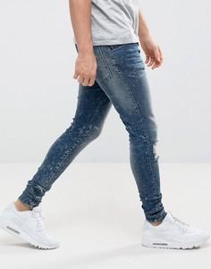 Выбеленные зауженные джинсы с потертой отделкой и молниями SikSilk - Синий