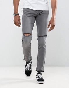 Зауженные джинсы с рваной отделкой и развернутым краем Antioch - Серый