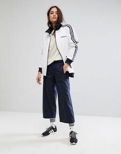 Темно-синие укороченные брюки adidas Originals - Темно-синий