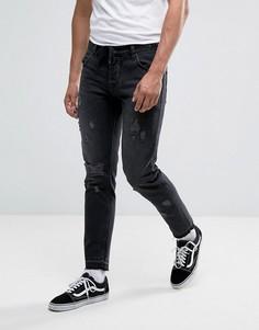Выбеленные черные узкие джинсы с рваной отделкой и затягивающимся шнурком ASOS - Черный