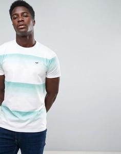 Синяя футболка узкого кроя в широкую полоску с круглым вырезом и логотипом Hollister - Синий