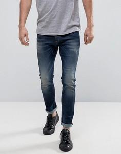 Выбеленные зауженные джинсы с потертостями United Colors of Benetton - Синий