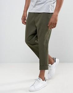 Суженные книзу строгие брюки заниженного кроя с широкими отворотами ASOS - Зеленый