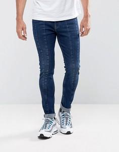 Темно-синие джинсы скинни со вставками ASOS - Синий