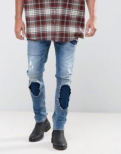 Синие выбеленные зауженные джинсы в винтажном стиле с рваной отделкой ASOS - Синий
