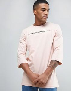 Розовая футболка с рукавами 3/4 и надписью на русском языке Puma 57443402 - Розовый