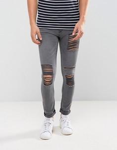 Серые выбеленные джинсы скинни с рваной отделкой New Look - Серый