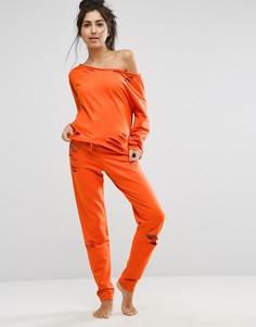 Джоггеры с прорехами ASOS LOUNGE - Оранжевый