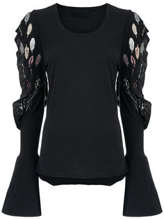 cut out details top Andrea Bogosian