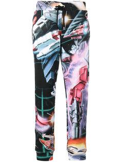 спортивные брюки с изображением трансформеров Moschino