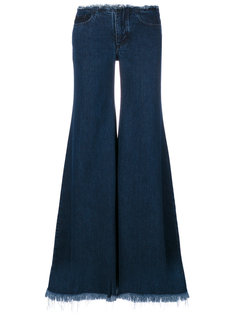 джинсы клеш с бахромой  Marquesalmeida