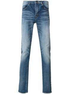 джинсы с потертой отделкой Saint Laurent