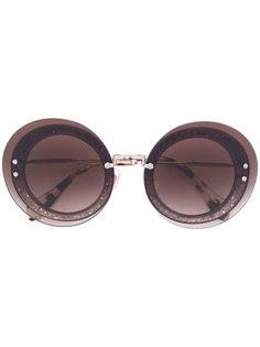 солнцезащитные очки в круглой оправе Miu Miu Eyewear