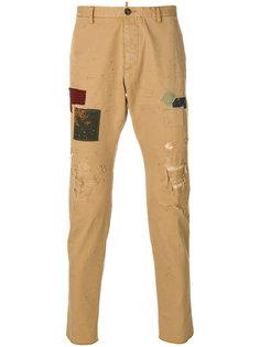 брюки с заплатками Dsquared2