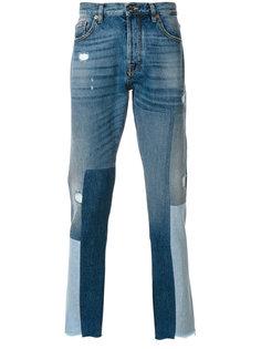 джинсы с заплатками Valentino