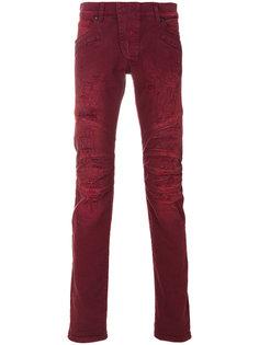 джинсы с рваными деталями Pierre Balmain