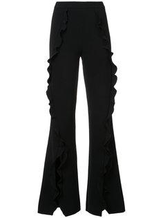 расклешенные брюки с оборками Saloni