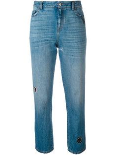 выбеленные джинсы с люверсами  Christopher Kane