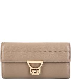 Кожаный кошелек с застежкой на замок Coccinelle