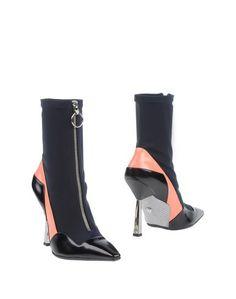 Полусапоги и высокие ботинки Versace
