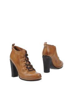 Полусапоги и высокие ботинки Buttero