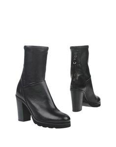 Полусапоги и высокие ботинки KEB