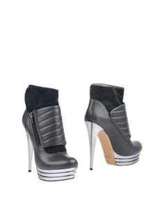 Полусапоги и высокие ботинки Casanovas