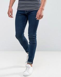 Темные супероблегающие джинсы Weekday - Синий