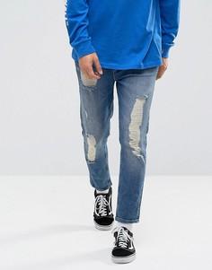 Зауженные темно-синие джинсы с прорехами и заплатками ASOS - Синий